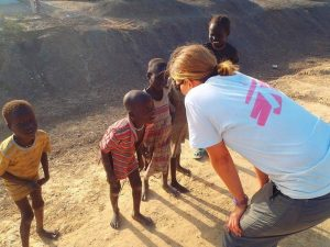 Dr. Stephanie Falz interacts with refugee children.